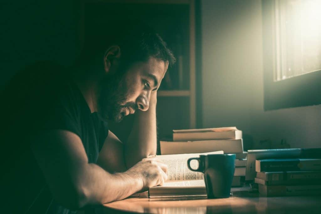 Picture of man focusing on his studies