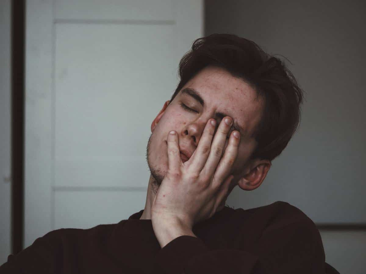 A photo of a man who is tired.