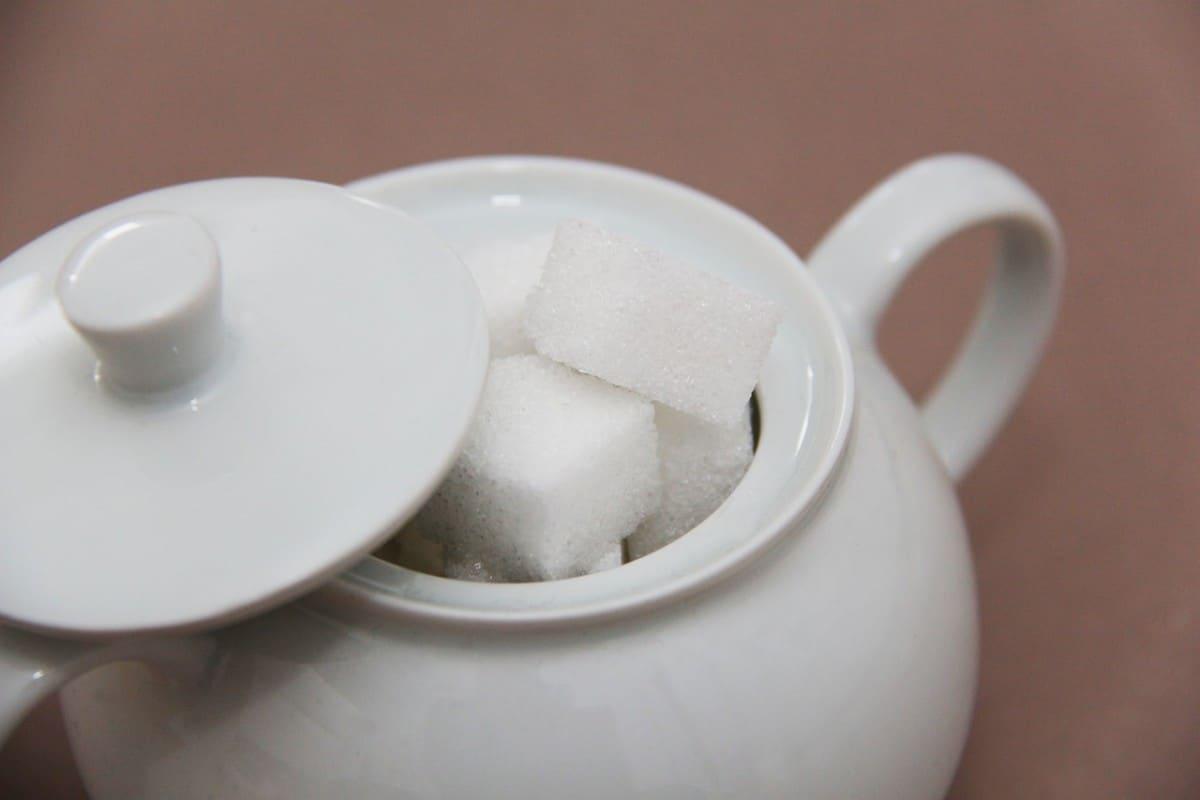 A photo of sugar cubes in a pot.
