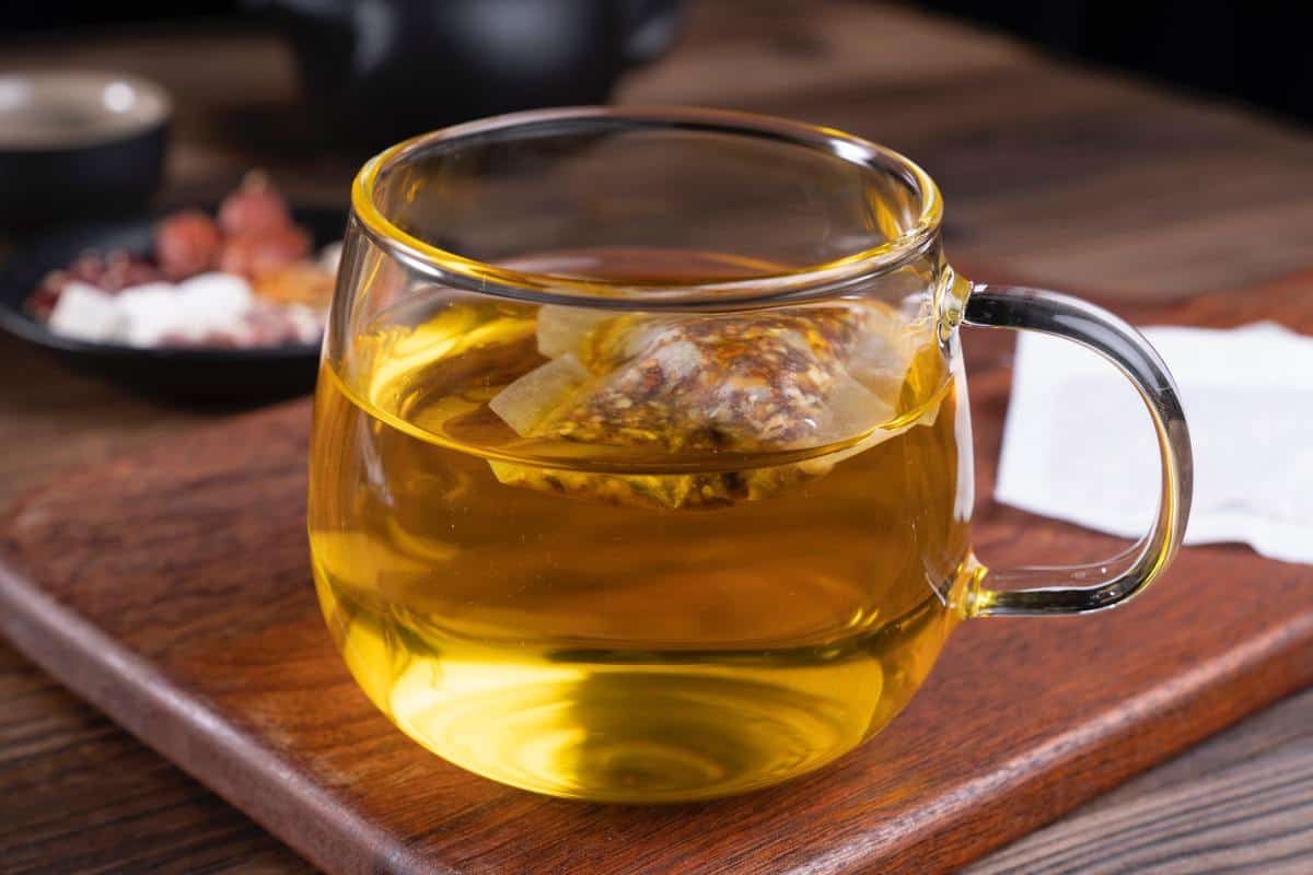 A photo of brewed green tea in a brown table.