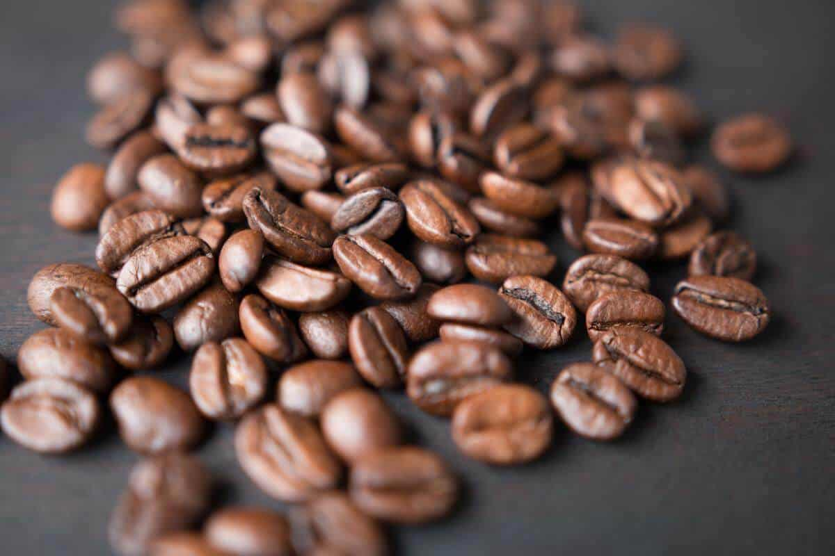 A picture of caffeine beans with black background.