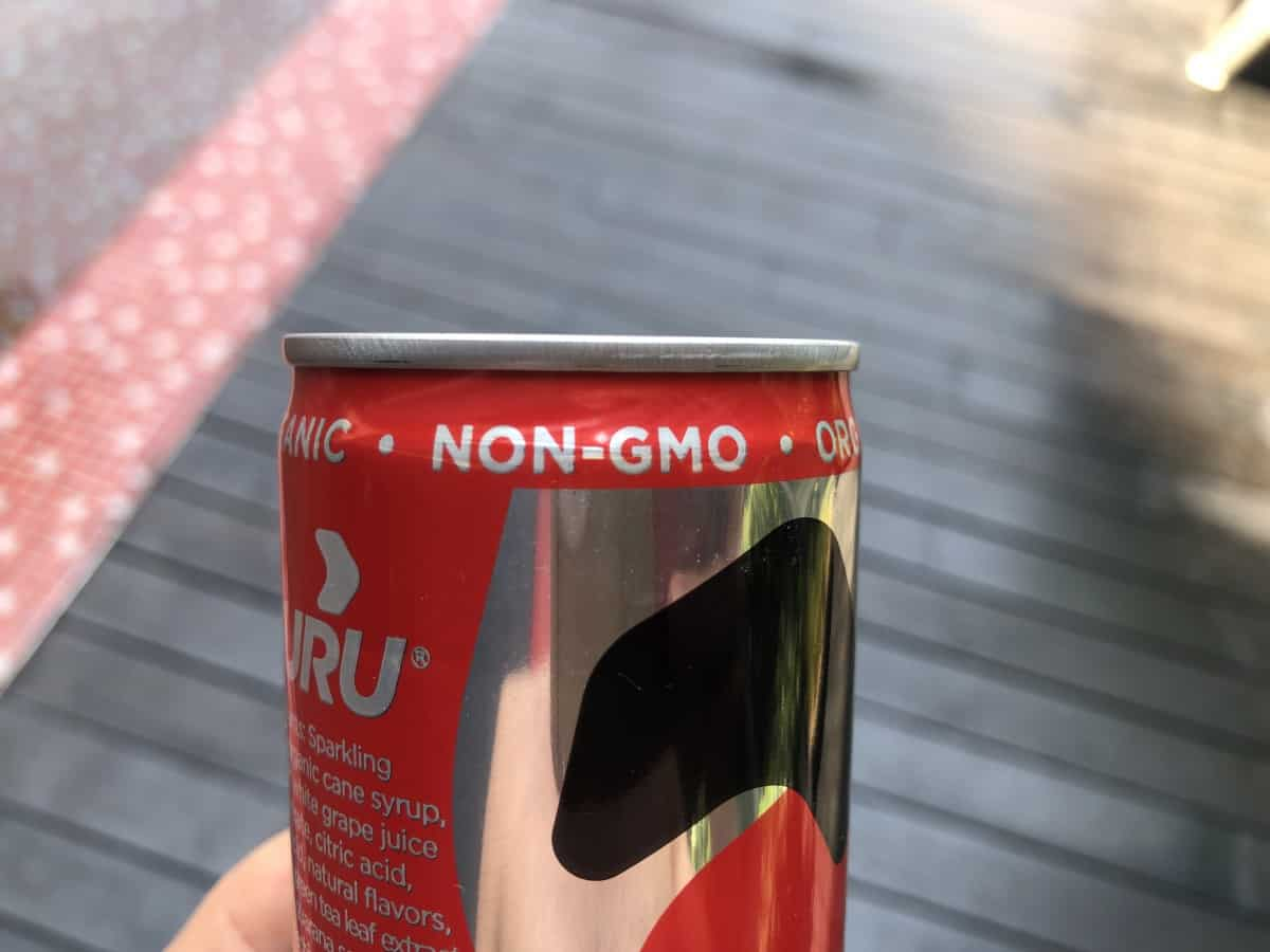 A photo of Guru energy drink stating it is Non-GMO.
