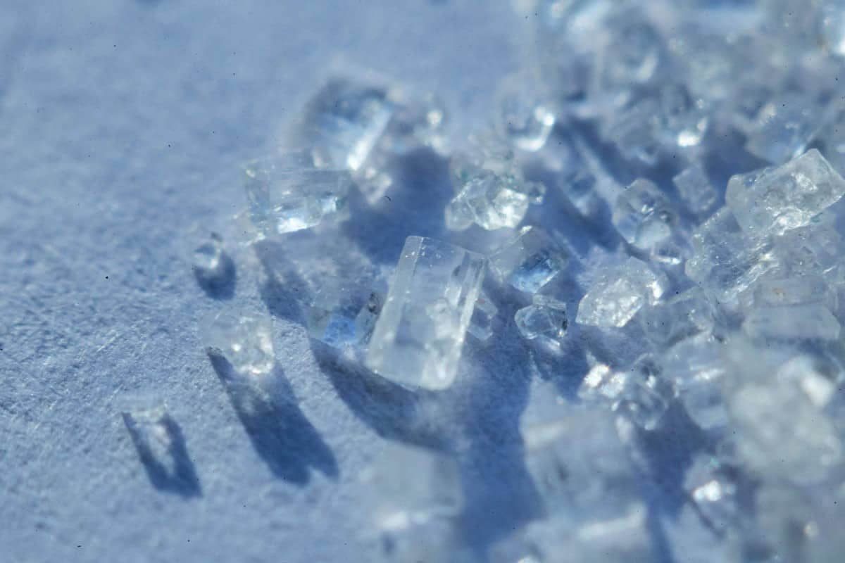 A photo of sugar cubes in a blue background