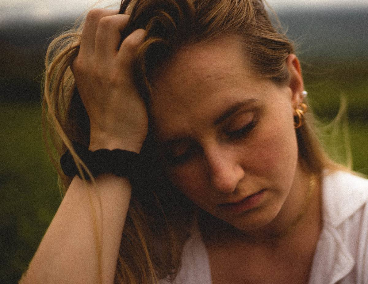 A photo of a tired female.
