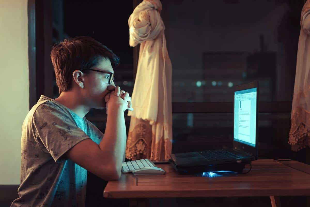 A photo of a boy staring at the computer.