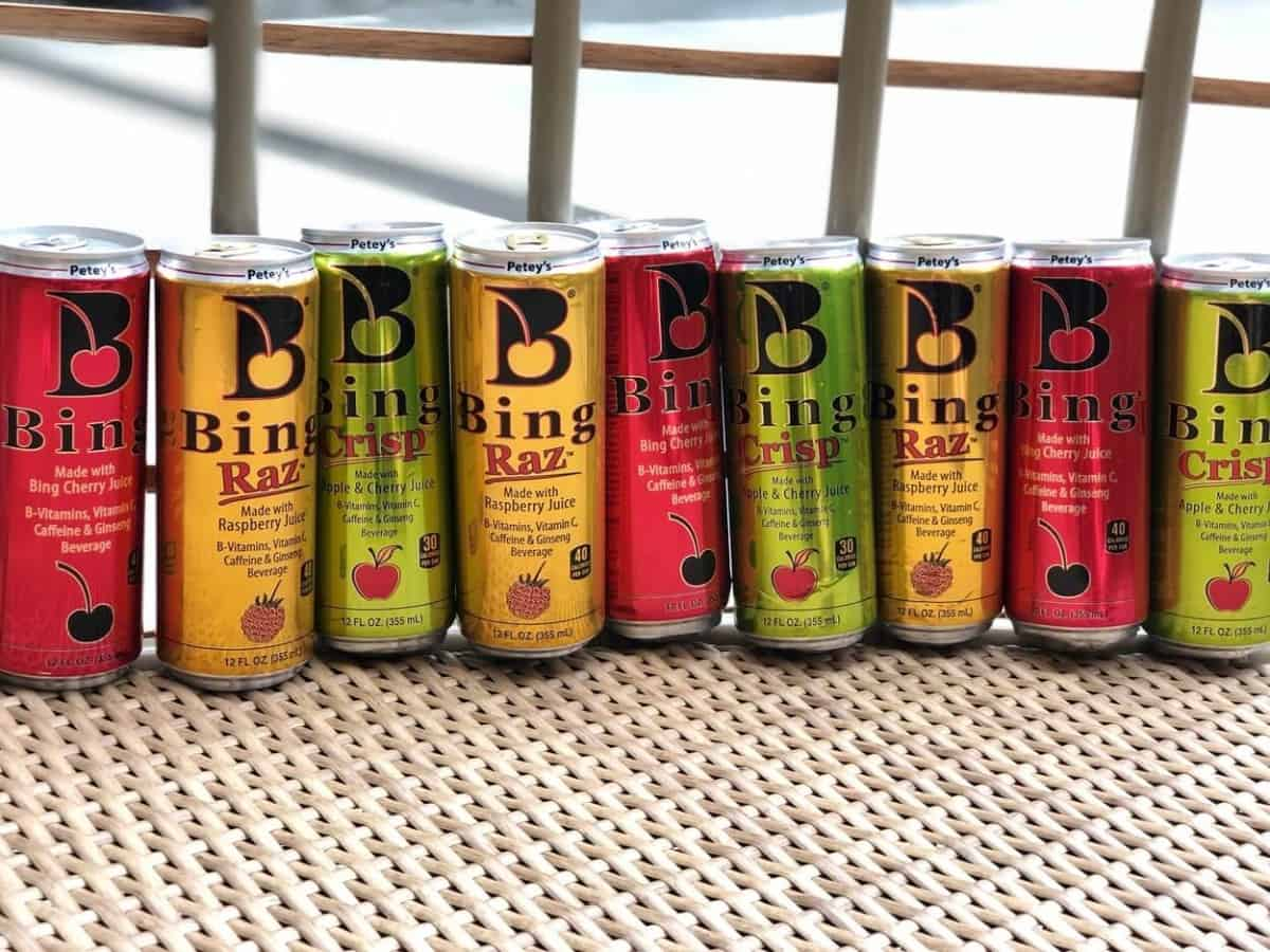 9 cans of bing energy drinks in different colors and flavors