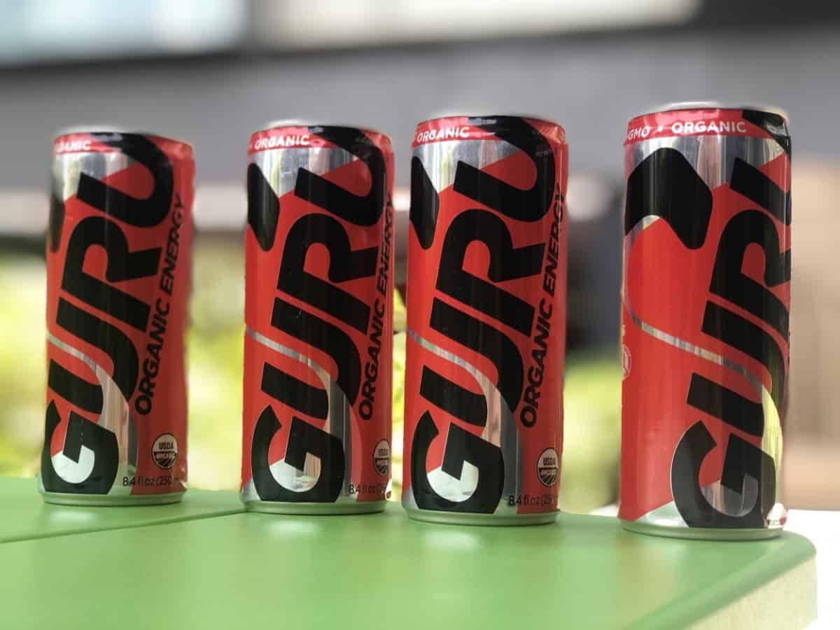 Four cans of Guru Organic Energy drink