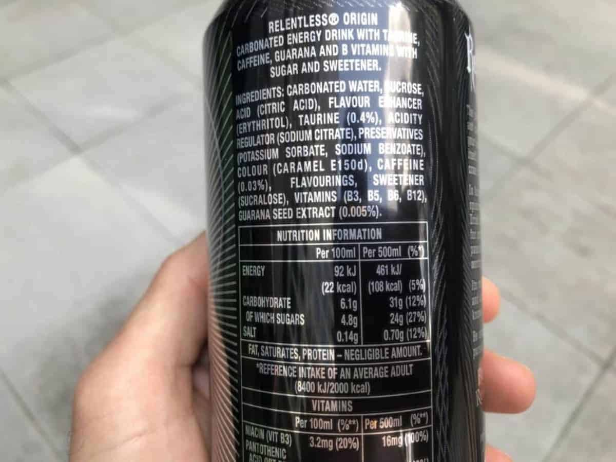 A photo of the nutrition facts of Relentless energy drink, held in a hand