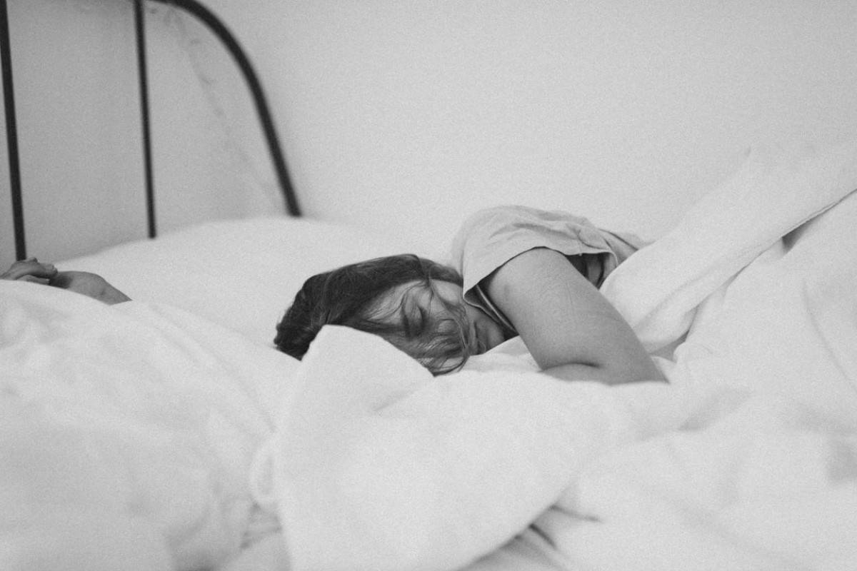 A photo of a young girl sleeping