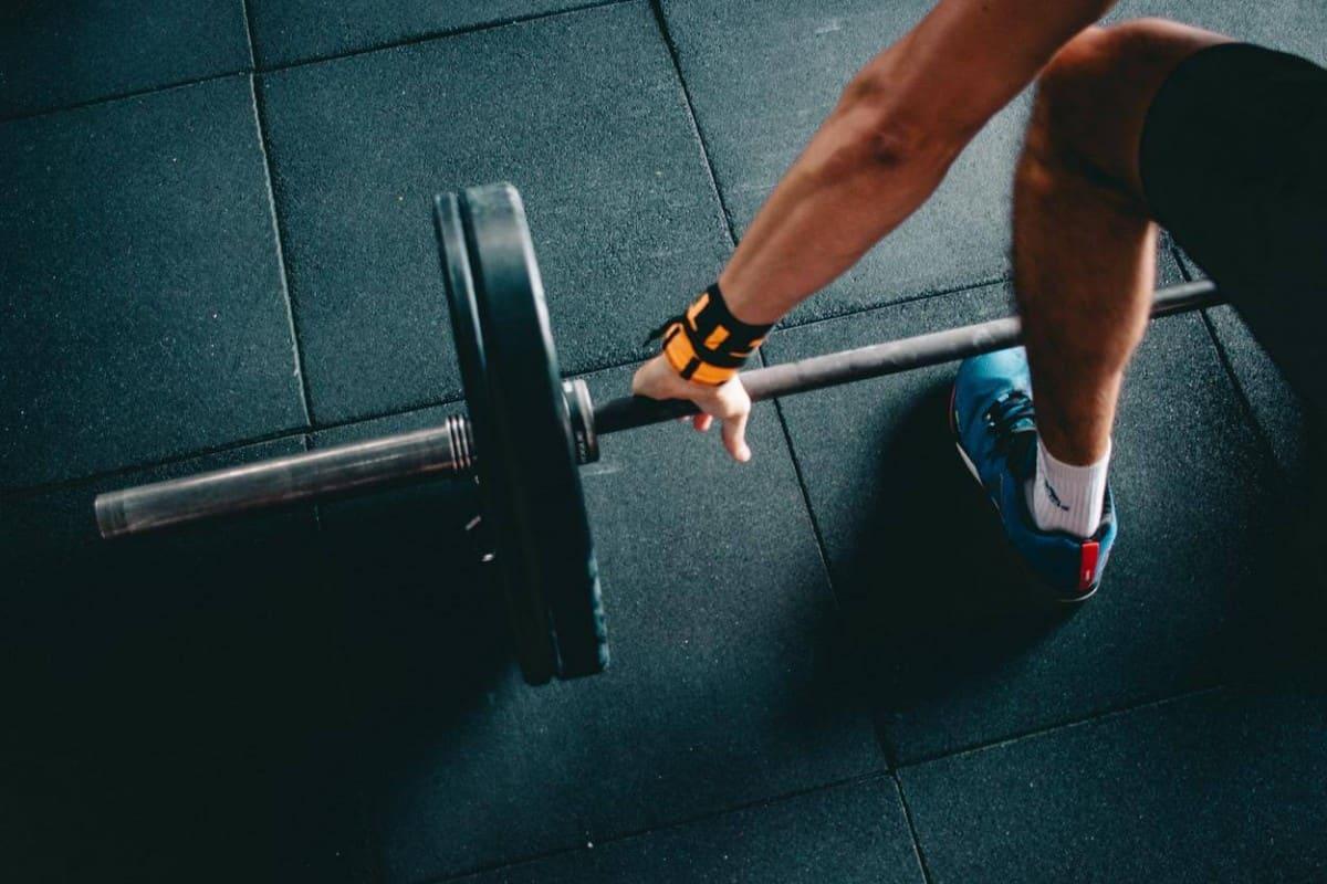 A man doing weight lifting.
